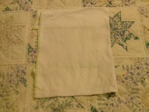 Fold the entire diaper in half.